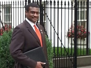NASW CEO Angelo McClain enters White House to attend an Oct. 16 meeting on the Affordable Care Act.