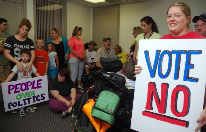 Community members protest BCRA in the office of Sen. Jerry Moran in Kansas. Photo courtesy of Yahoo.