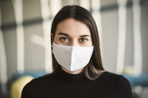Beautiful girl with medical mask to protect her from virus.