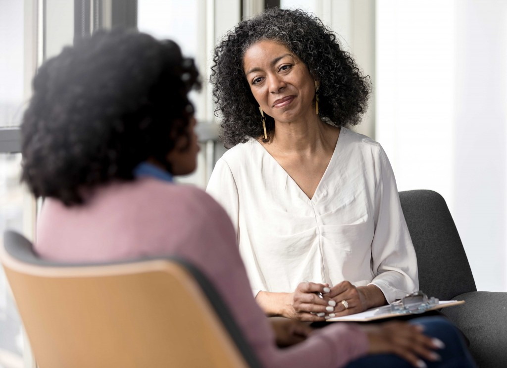 Social Worker Meeting With Female Client