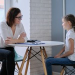 Communication session of school psychologist and girl 9, 10 years