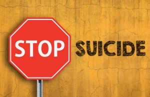 STOP SUICIDE message written on wall