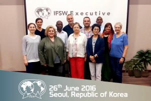 NASW President Darrell Wheeler, back row at right, stands with the newly elected IFSW Executive Committee.