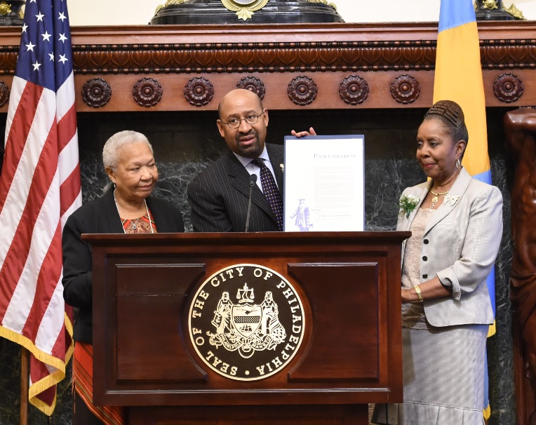 Philadelphia Mayor Michael Nutter presents the city's Social  Work Month Proclamation to Doris Smith, Chair of the Civil Service Commission for the City of Philadelphia (left) and Gwen Phillips, Chair of the Social Work Month Planning Committee.