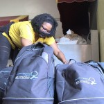 Social worker Sakia Gable Dixon, LICSW, organizes book bags and school supplies for distribution to families in her Alabama school district.