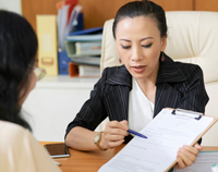 Social Worker At Desk With Client