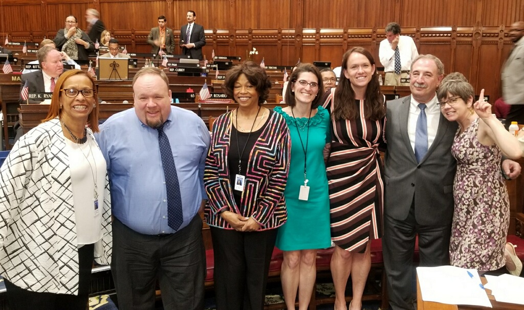 The six social workers who are members of the Connecticut House and Rep. Jonathan Steinberg, who is chair of the Public Health Committee, pose after the social work title protection bill passed. In the photo (from left to right): Reps. Toni Walker, Rick Lopes, Pat Wilson Pheanious, Cristin McCarthy Vahey, Jillian Gilcrest, Jonathan Steinberg and Anne Hughes. McCarthy Vahey and Gilchrest are members of NASW.