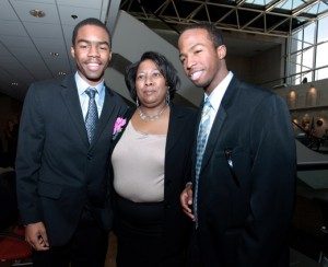 Thomas McRae (left), adoptive mother Joi Morris, and adoptive brother Dawson Hylton.