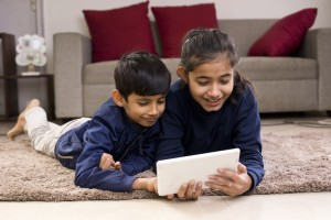 Children enjoying media content on digital tablet