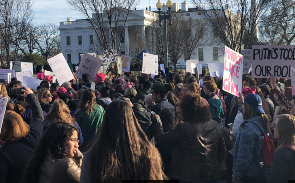 March participants gather in front of the White House. Photo by Mel Wilson.