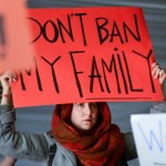 A woman protests President Trump's immigration executive order outside San Francisco International Airport. Photo courtesy of Reuters.