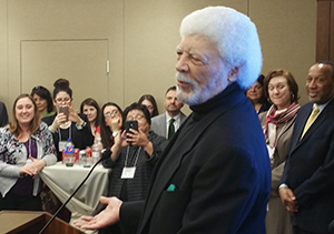Ron Dellums speaking at podium while audience listens